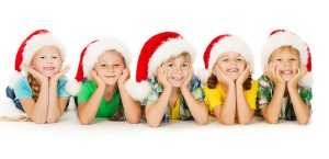 bigstock-Christmas-Kids-Smiling-In-Red--51937558